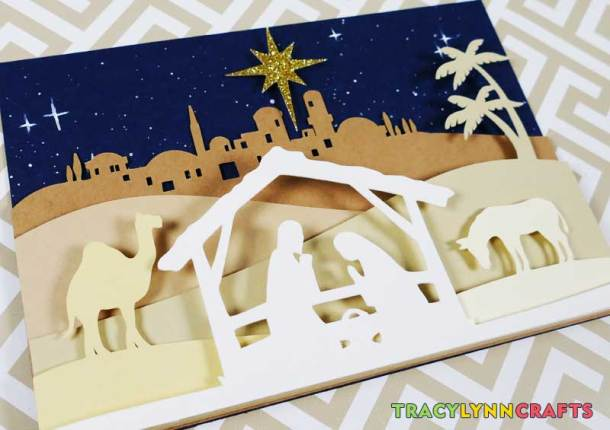 Final layer of the cut paper nativity scene applied