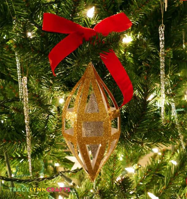 This silver and gold decoration will capture the lights on your Christmas tree