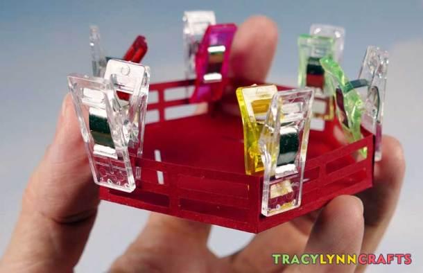 3D Paper Lighthouse - Clip the railing pieces until the glue sets