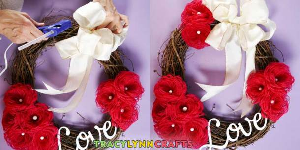 Loopy Burlap Flower Valentines Wreath - Hot glue the bow to the wreath and add the extra flowers