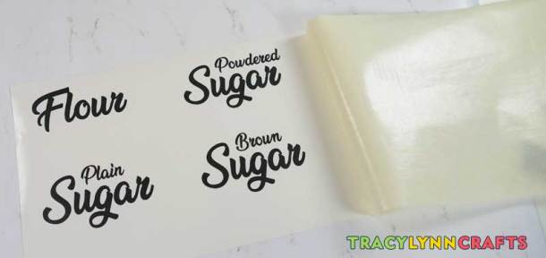 for your kitchen canister labels, adhere the transfer tape to one side