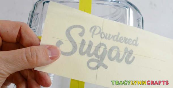 Mark the horizontal and vertical centers of the kitchen canister labels