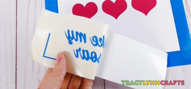 Remove the vinyl lettering from the carrier paper using the transfer tape
