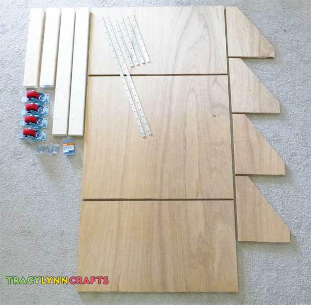 This picture is all the cut pieces and the hardware laid out for the drop-leaf roll-away craft table