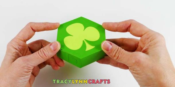 Fold the top of the shamrock box onto the glued tabs and hold.