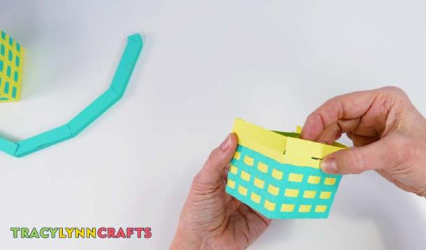 Attach to the top of the woven paper basket