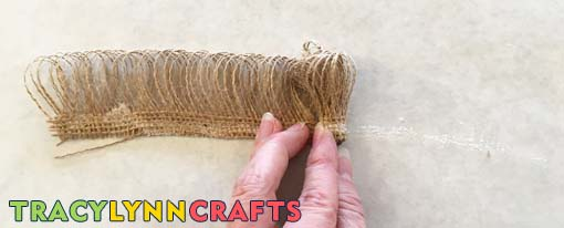 Finish rolling the burlap onto the flower stem until you get to the end of the burlap