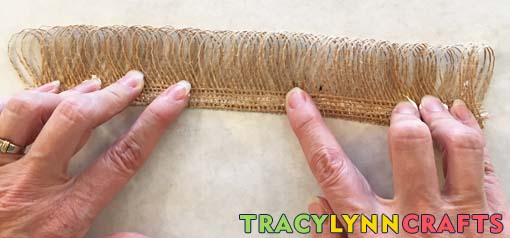Hold the glued edges of the burlap together for about a minute