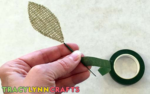 Wrap the florist tape down the stem of the leaf