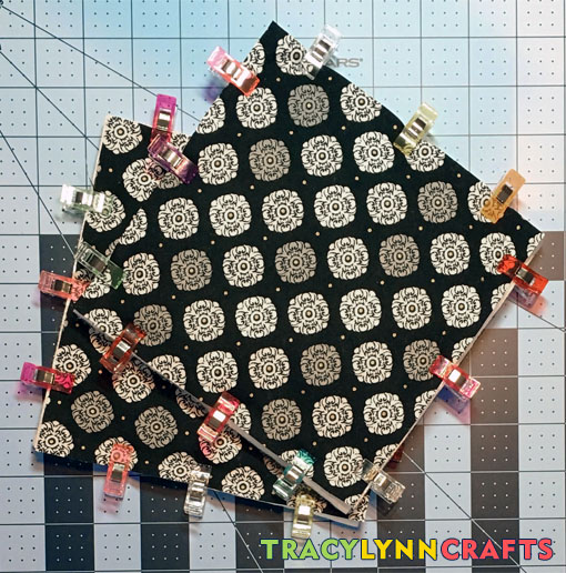 Assemble the layers of the pot holders and clip or pin them together