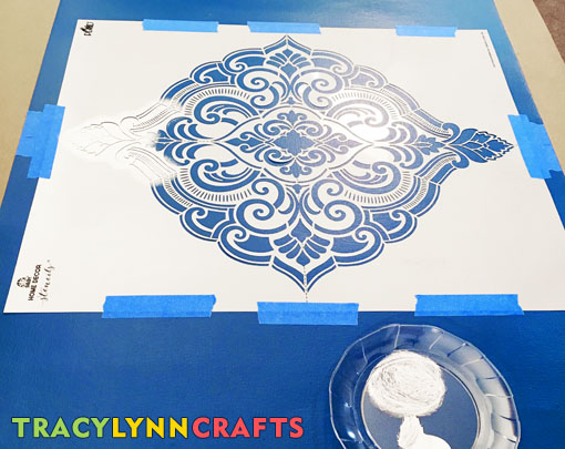 Add your paint to the palette and begin stenciling