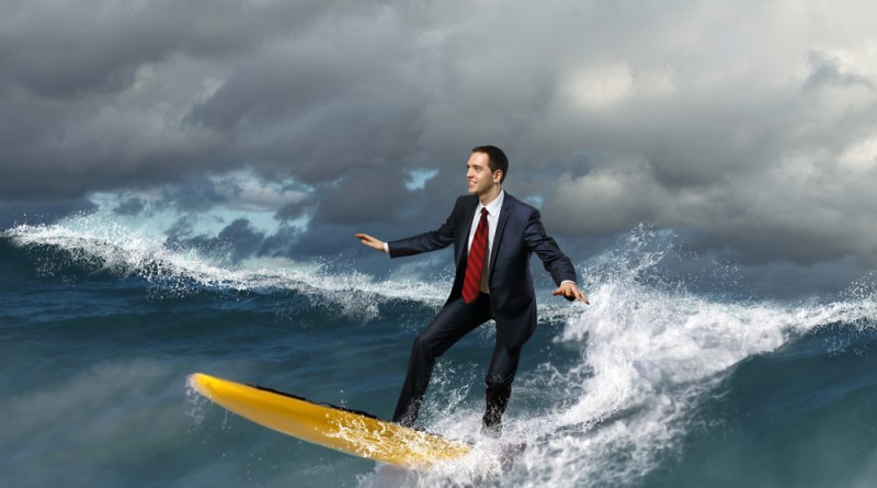 business person surfing a wave