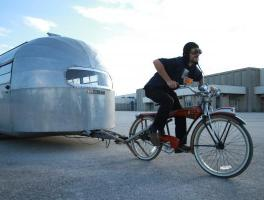 Man towing Airstream with Bike