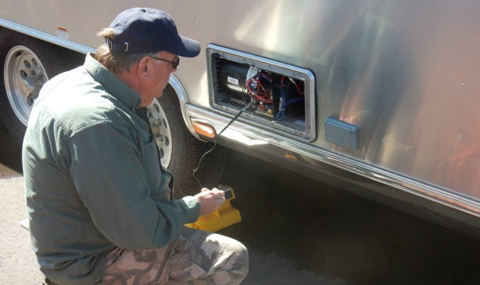 Rex gets down to work looking for the source of our Airstream Furnace problem.
