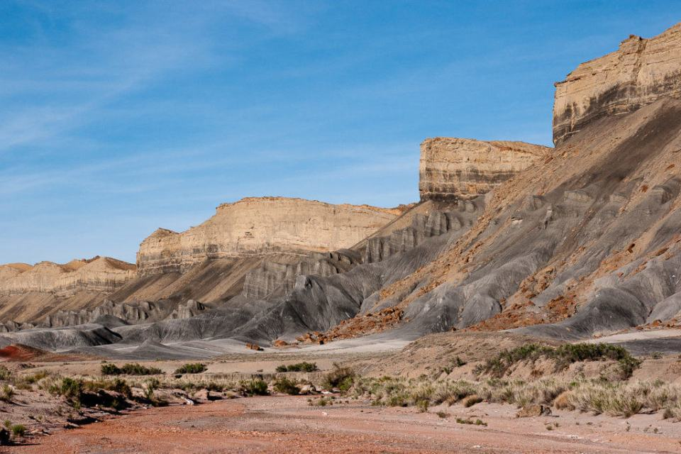 Caineville Reef topped by buttery colored cliffs