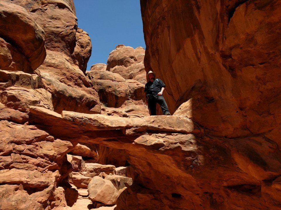On a rock behind the arch