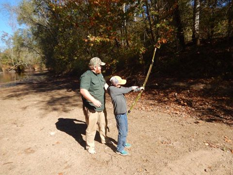 photo of day campers with a bow
