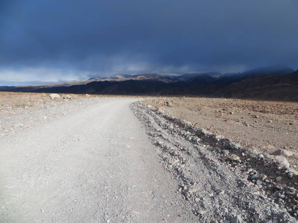 My dad took a photo of the ominous clouds hanging over Titus Canyon. This road was the starting stretch of the race and headed straight up to the canyon entrance.