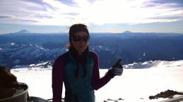 Photo: Annette. St. Helens, Adams, and Hood all in the background from Camp Muir. You'd think I'd be more excited but it was so windy I could barely smile!