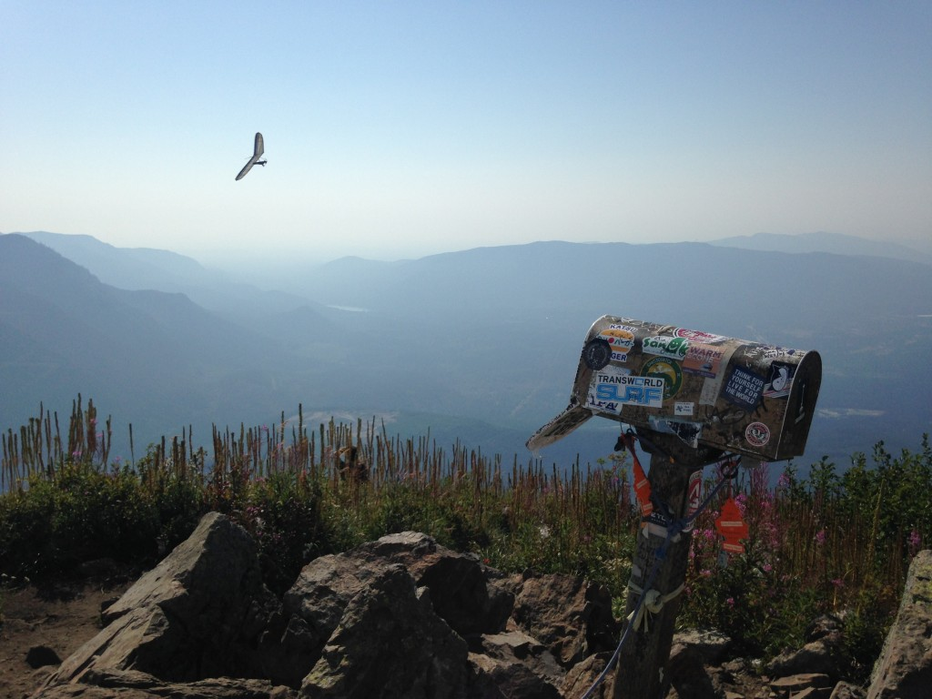 A hang glider making laps over the Mailbox summit. He sure was having a grand time yelling down at everyone