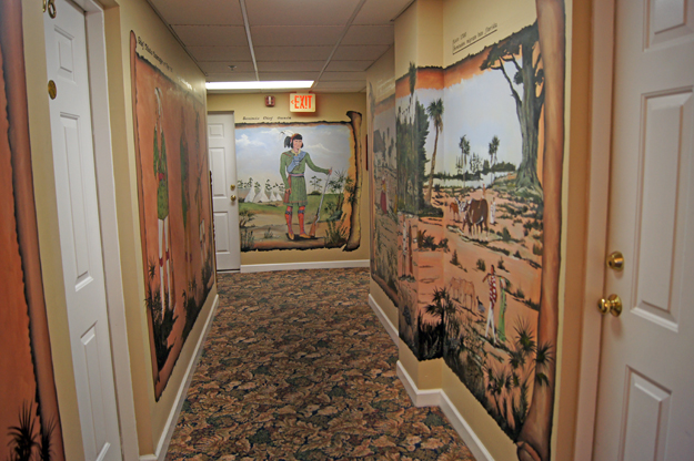 Murals along the hallways of Seminole Inn