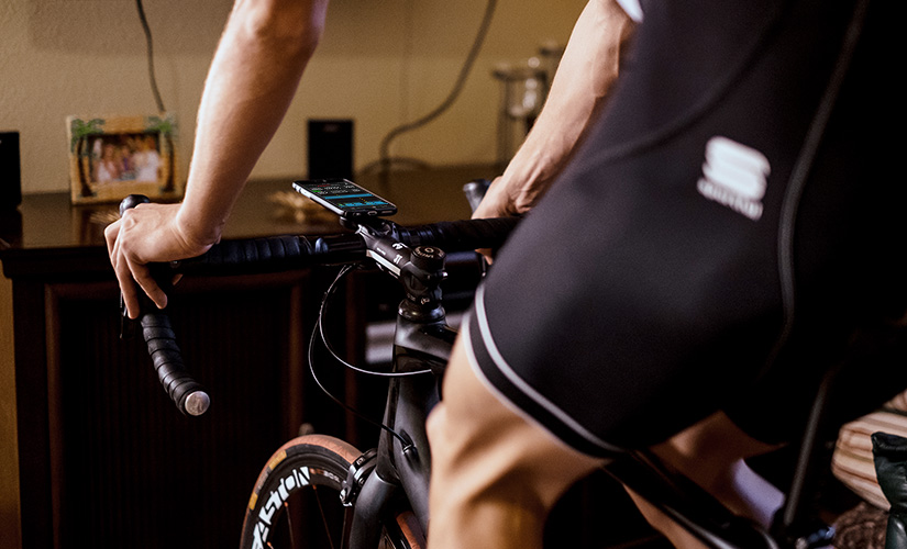 A cyclist is completing a winter cycling training plan indoors.