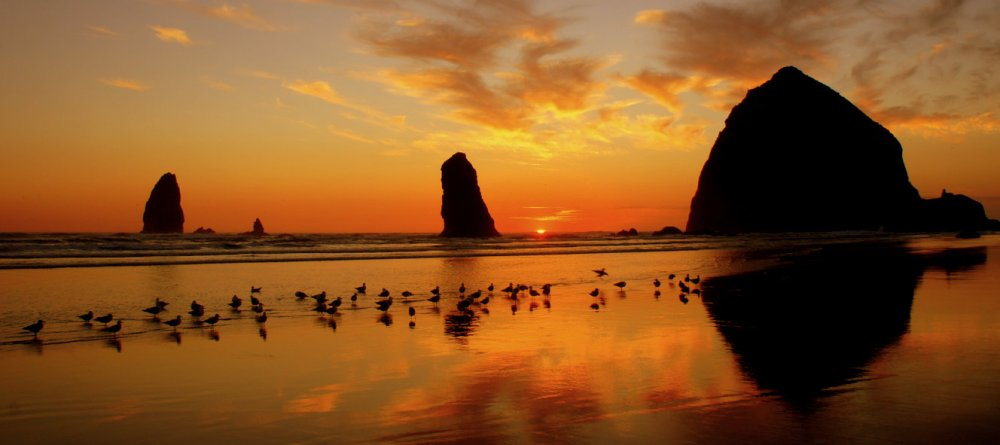Sunset at Haystack Rock on the Oregon Coast.