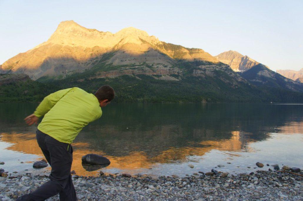 Skipping rocks in Waterton, Alberta at sunset.