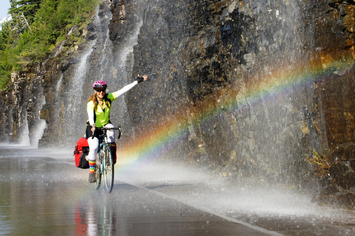 My pot of gold at the end of a rainbow! Riding next to Weeping Wall in Glacier on Going-to-the-Sun Road.