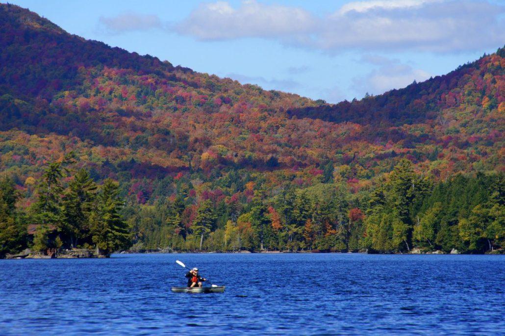 A kayaker on Blue Mountain Lake.