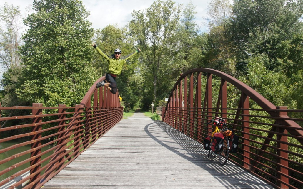 Leaping from a photo vantage point on an Erie Canal bridge.