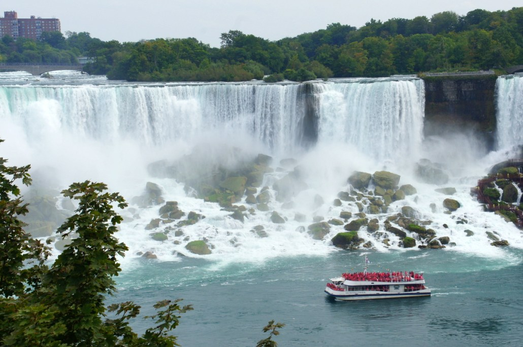 A tour boat cruises below American Falls, which carries about 1/10 the water of Horseshoe Falls.