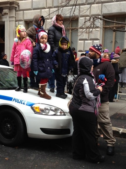 Kids snag a better view of the parade. (C photo credit)