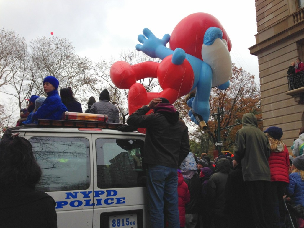 Papa Smurf rolls on by as kids watch from the top of a police van (C photo credit)
