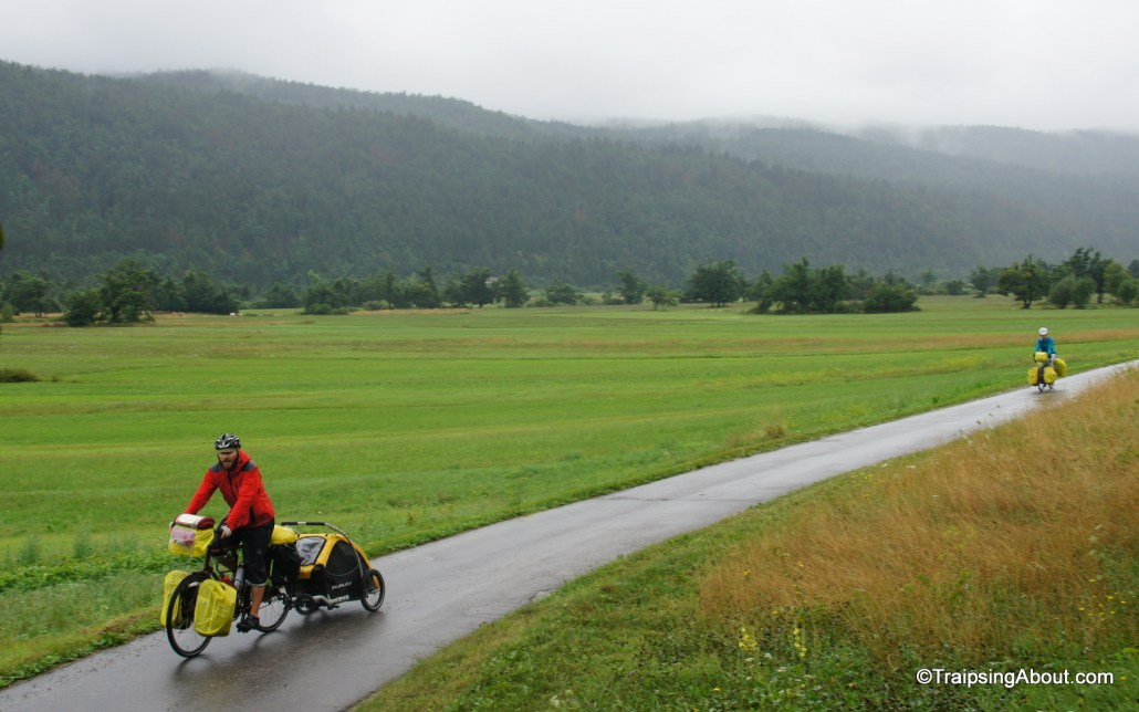 Jen and Dave from Long Haul Trekkers cruise through a misty day in the rolling valleys of Slovenia.