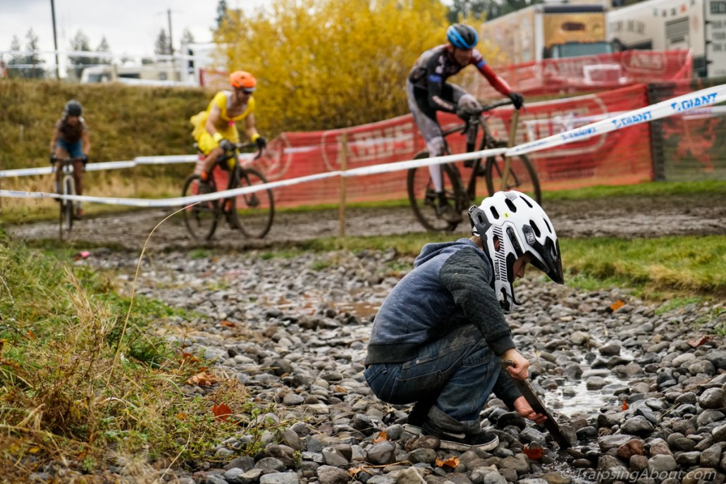 A future shredder playing in the mud while his dad races.