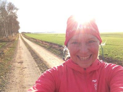 Löpning i solskenet efter regnet