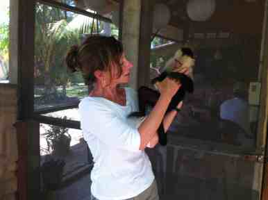 Chimi monkeying about with one of the retreat's guests