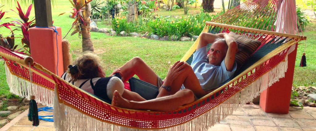 Larry relaxing in one of Tranquility Bay's hammocks in the garden