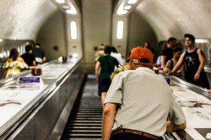 Professional Photography Old White Man With Orange Hat Ascending Escalators Inside Brixton Train Station South London