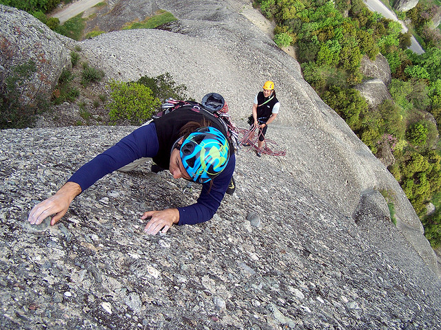 rock climbing benefits,rock climber,climber with helmet,