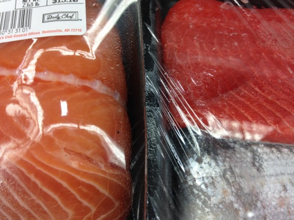The wild salmon is dark red and the farmed salmon is light orange in color, better oils in wild salmon, higher Omega 3 levels in wild salmon, health information, health education, nutrition information, nutrition tips