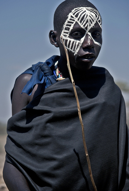 Maasai warrior after circumcision ceremony, Maasai boy after rite of passage ceremony, move into manhood, life transitions, ceremonies to mark changes in status or age