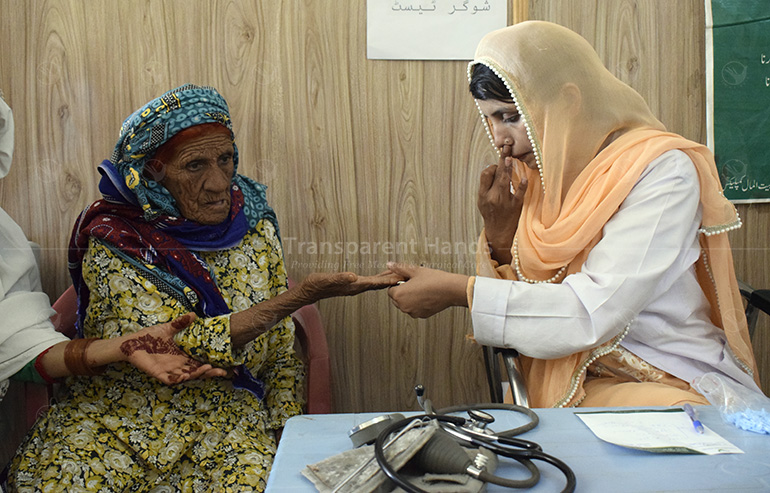 doctor checking patient