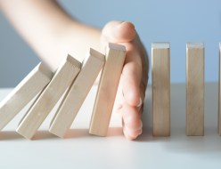 Stopping the domino effect concept with a business solution and intervention
