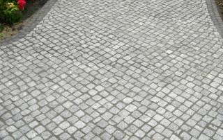 Granit Natursteinpflaster im Passe-Verband