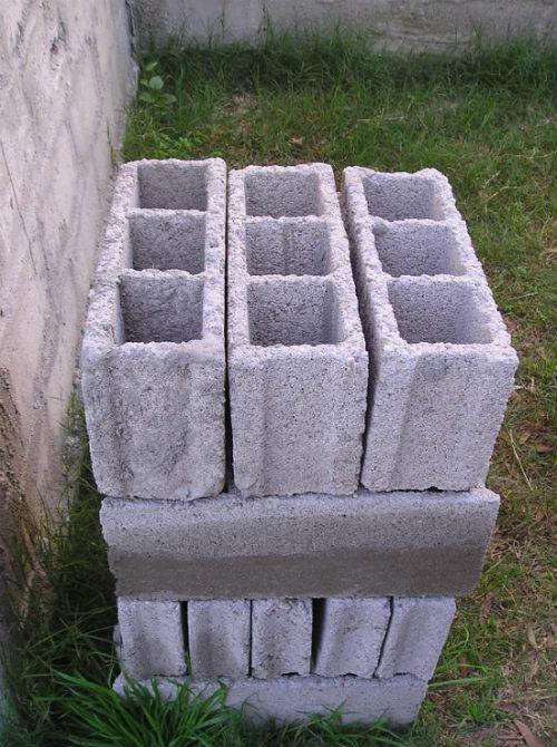1 sacs de ciment combien de parpaing
