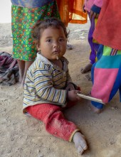 Child in a hill tribe village between Kengtung and the Chinese Border