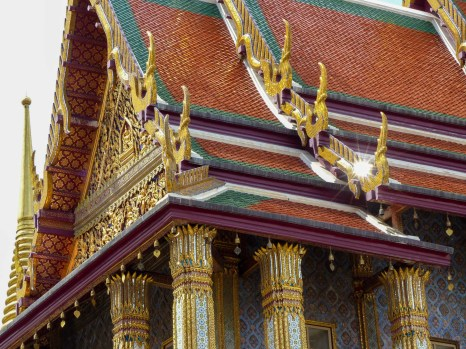 Tiled, richly ornamented roof in Bangkok's Grand Palace