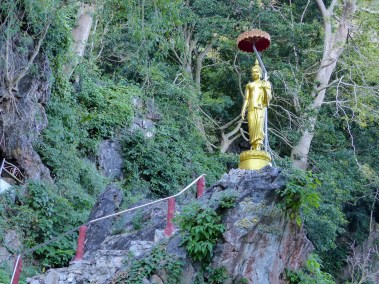 Buddah statue at the cave entrance of Wat Tham Pla - The Monkey Temple